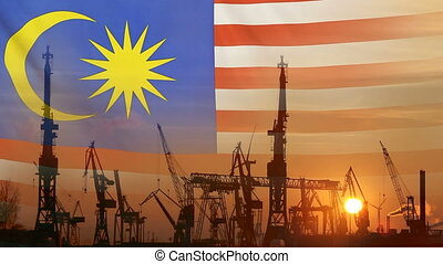 Industrial concept with Malaysia flag at sunset, silhouette...