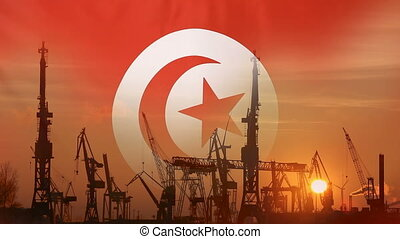 Industrial concept with Tunisia flag at sunset, silhouette...