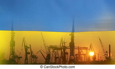 Industrial concept with Ukraine flag at sunset