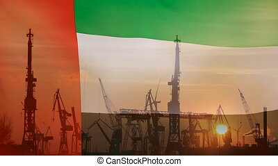 Industrial concept with United Arab Emirates flag at sunset,...