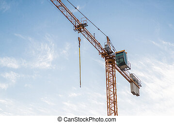 Industrial Construction Crane on Blue Sky Background.