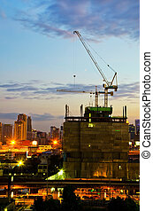 Industrial construction cranes and city