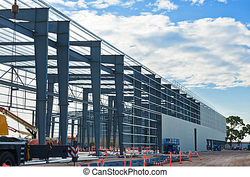 Industrial construction site against the blue sky