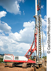 industrial construction site with drilling rig making holes