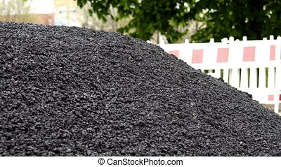 Industrial Construction Site With Pile of Loose Asphalt...
