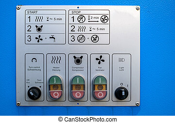 Industrial control panel buttons and lights on blue background