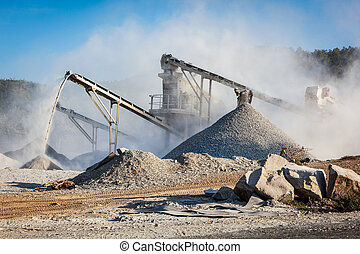 Industrial background - crusher rock stone crushing machine at open pit mining and processing plant for crushed stone, sand and gravel