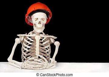 Industrial death - A skeleton with hard hat symbolizes death...