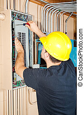 Industrial Electric Work - Electrician working on a breaker...