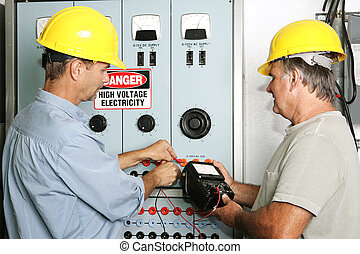 Industrial Electricians - Electricians measuring the voltage...