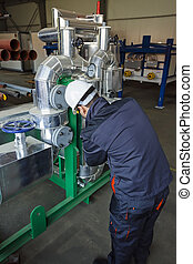 Industrial engine control - Man worker checking advanced ...