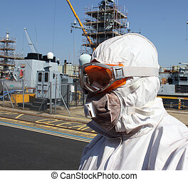 an industrial engineer / cleaner wearing full ppe, personal protection equipment