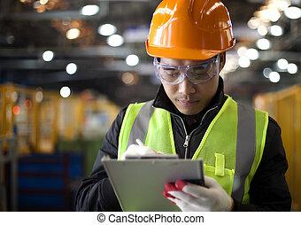 Industrial engineer - industrial engineer writing on notepad...