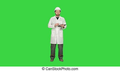 Industrial Engineer Using Tablet, talk on camera on a Green Screen, Chroma Key.