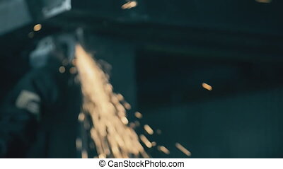 Industrial engineer working on cutting a metal and steel with compound Metal Angle Grinder Machine. dynamic video