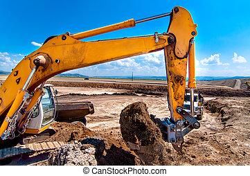 Industrial excavator bulldozer digging in sandpit