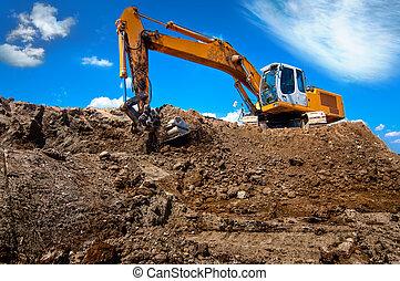industrial excavator bulldozer in sandpit with raised bucket