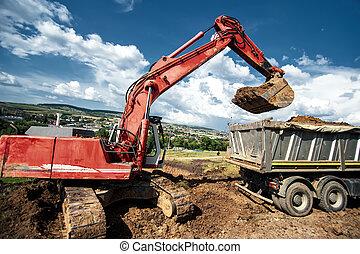 Industrial excavator loading soil material