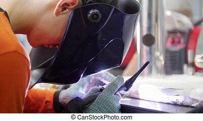 Industrial factory. A man in helmet working. Welding