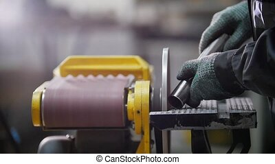Industrial factory. Grinding machine. Grinding a thread....