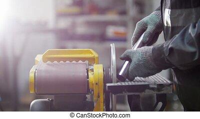 Industrial factory. Grinding machine. Preparing to grind the...