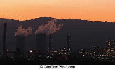 Industrial factory producing smoke, air pollution. Global...
