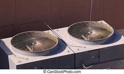 Industrial fan on top of a building