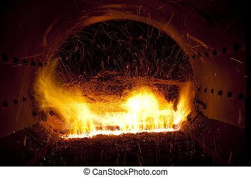 Industrial furnace - Close up colorful fire in industrial...
