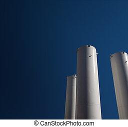 Industrial gas tank - Industrial storage gas tank on blue...