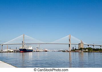 Industrial Harbor Under Suspension Bridge