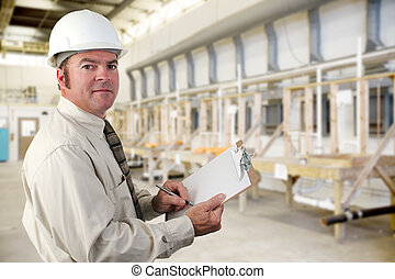 Industrial Inspector - Inpector performing an audit of a ...