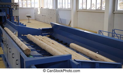 Sawmill machine for cutting wood boards by using rolling metal cylinders and set blades, lots of sawdust