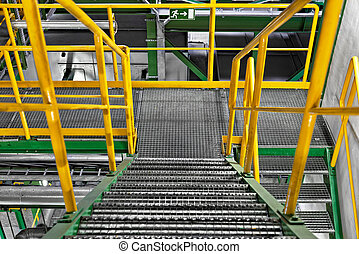 Industrial Interior with large staircase - Industrial...