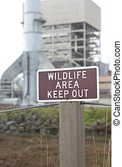 Industrial Irony #1 - A wildlife area contains a large...