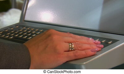 Industrial keyboard with trackball - Woman hand operating...