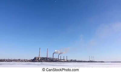 Industrial landscape of the area. Smokestacks pollute atmosphere, heavy industry