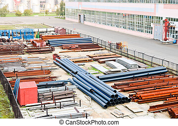 Industrial landscape. Panoramic view of the technological pipes. Rusty pipes, blue rubies, production communications. Repair buildings in production. Against the background of a misty sky