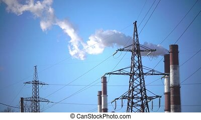 Industrial landscape. power line and smoke from pipes of combined heat and power plant