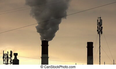 Industrial landscape. power line and smoke from pipes of combined heat