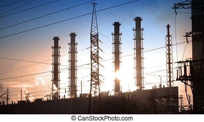 Industrial landscape. the power line and smoke from pipes of combined heat and power plant