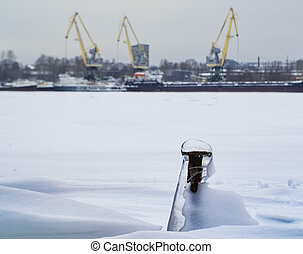 Industrial landscape with cranes and frozen screw
