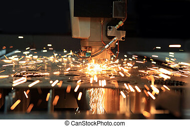 The industrial laser cutting torch cuts preparations from metal