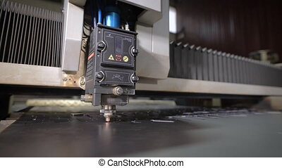 Industrial laser cutter with sparks. The programmed robot...