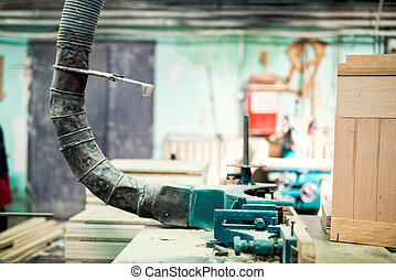industrial lathe tool, drilling and vacuuming the saw dust ...
