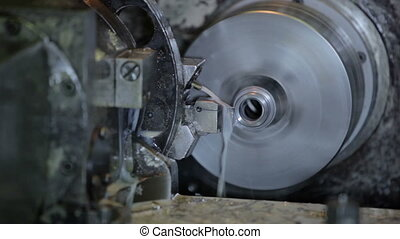 Industrial lathe works metal with precision