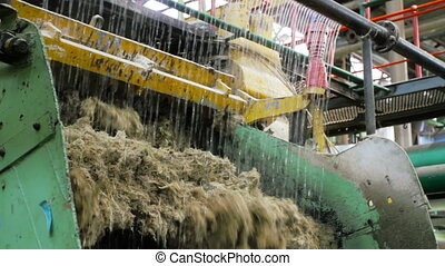 Industrial Machine - Sugarcane pulp (bagasse) coming out of...
