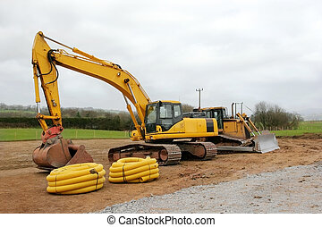 Industrial Machinery - Large yellow track machine with a...