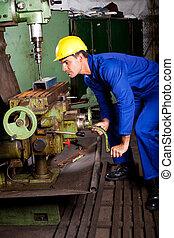 industrial machinist operating machine tool