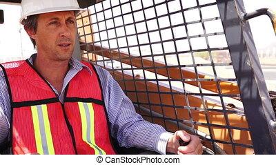 Industrial Male Worker On Skidsteer