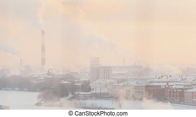 Industrial manufactoring. A city full of smoke. Ecology problem. Winter time